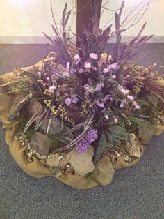 Bottom of cross. Rocks and silk flowers. Created a rough, wild flower look.