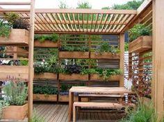Back deck or deck (herbal garden) idea. (also nice screening device--grown vertically--from urban neighbors).