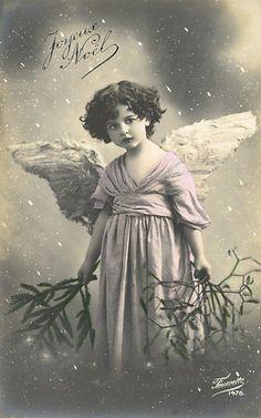 Vintage Joyeux Noel postcard... child with Angel Wings
