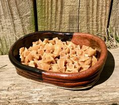 ceramic dish of small peanut butter dog treats
