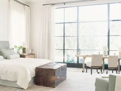Modern Rustic California Home Master Bedroom Floor Ceiling Steel Windows Seafoam Green White Bedding