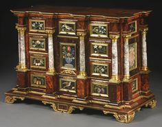 A GERMAN BAROQUE PIETRA DURA-INLAID, ORMOLU AND MARBLE-MOUNTED PARCEL-GILT TORTOISESHELL CABINET AUGSBURG, SECOND HALF 17TH CENTURY, THE PIETRA DURA PLAQUES FLORENCE, OPIFICIO DELLE PIETRE DURE, 17TH CENTURY