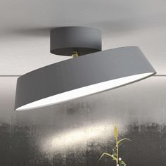Specifications Colour: Available in Grey and White Material: Metal Projection: Shade diameter: Colour Temperature: IP-degree: Class: Earth Dimmable Led Ceiling Lights, Low Ceiling Lighting, Led Technology, Cool House Designs, White Light, Led Lamp, Light Bulb, Wall Lights, Design Minimalista