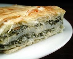 Easy Spanakopita from Food.com: A great finger food for get togethers. Easy to make and so good with flaky phyllo dough and spinach.