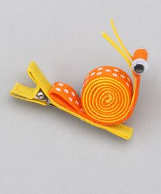 Take a look at this Orange Rolled Snail Clip by Bubbly Bows on #zulily today!