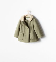 THREE-QUARTER COAT WITH A SHEARLING-LINED COLLAR