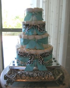 Diaper Cake for a very contemporary French Chic Baby Nursery......complete with black & crystal chandelier.
