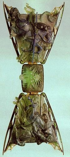 Lalique 1903-04 signed 'Tourna-ment' Chest Ornament; a brooch in three sections. The plaques show armored knights on galloping horses. In the center in high relief is the head of a mythological animal w/gaping jaws: museo.gulbenkian.pt