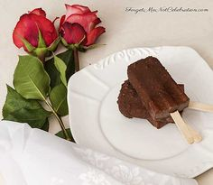 These Mexican Chocolate Popsicles are made with dark cocoa and cinnamon.  They are covered with a dark chocolate shell that has sea salt and chocolate nibs.  A delicious summertime treat!  #chocolatepopsicles #popsicles #icecream