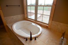 This relaxing bathtub will be perfect lined with candles. The Trinity #1304. http://www.dongardner.com/house-plan/1304/the-trinity. #MasterBathroom #Bathroom #HomePlan