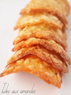 Après les financiers, une autre recette pour utiliser les blancs d'oeufs. J'ai trouvé cette recette sur le blog de Chantal Assiettes gourmandes. Jetez toutes vos recettes de tuiles aux amandes et gardez celle-là… elles sont à tomber par terre! Ingrédients (pour 20 tuiles): 125 g de sucre 125 g d'amandes effilées 1 gousse de vanille ...Read More