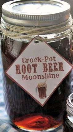 """If you like root beer you are going LOVE this alcoholic adult beverage recipe for Crock-Pot Root Beer Moonshine! Everclear grain alcohol or vodka is sweetened and flavored with root beer extract for this perfect sipping flavored """"moonshine"""" recipe! Root Beer Moonshine Recipe, Flavored Moonshine Recipes, Homemade Moonshine, Apple Pie Moonshine, Cherry Moonshine Recipe, Fireball Recipes, Lemonade Moonshine Recipe, Moonshine Alcohol, Peach Moonshine"""