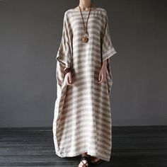 Comfort fit striped half sleeve loose cotton and linen maxi dress is suitable for casual wearMaterial: Linen,CottonDresses Length: Ankle-LengthPattern Type: StripedSleeve Length(cm): HalfNeckline: O-NeckSilhouette: LooseSkirt type: Large swingCo. Dubai Fashion, Hijab Fashion, Linen Dresses, Casual Dresses, Maxi Dresses, Cotton Dresses, Summer Dresses, Dress Plus Size, Cooler Look