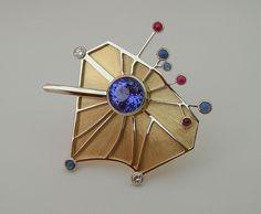 Brooch |  Scott Schreiber.  'Arc de Triomphe' 14K gold, Tanzanite, Diamond, Sapphire, Ruby