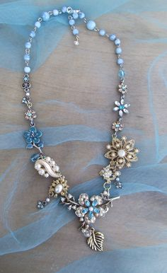 Repurposed Vintage Jewelry Assemblage, created with vintage brooches, earrings,necklaces and swarovski crystals. $49.95, via Etsy.