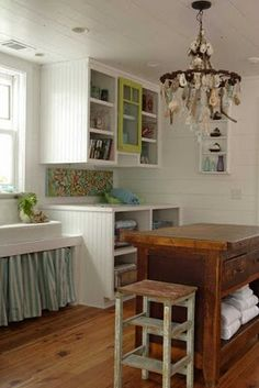 love this style, the island, the light fittings, the big farm sink and the painted wood paneling. Everything.