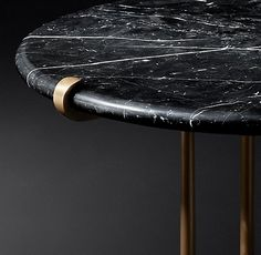 RH Modern's Ronan Marble Round Side Table:Inspired by a 1970s design, our table is a trifecta of marble, polished metal and clean lines. Three slender solid metal legs conclude in subtle clamps at the edge of the tabletop.
