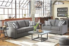 neutral gray loveseat and couch accented with white and gray pillows