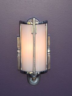 Exquisite Vintage Art Deco wall sconce, which is chrome plated with a curved milk glass shade. Antique lighting at its best if you need a single vintage bathroom wall sconce.