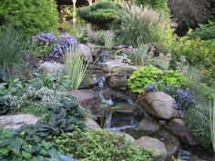 Gardens of the 1 Percenters Waterfall Landscaping, Pond Waterfall, Pond Landscaping, Landscaping With Rocks, Backyard Water Feature, Ponds Backyard, Koi Ponds, Backyard Ideas, Natural Pond