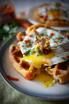 These cheddar sausage cornmeal waffles are packed full of sriracha, cheddar cheese and breakfast sausage. Top with a fried egg and call it breakfast.