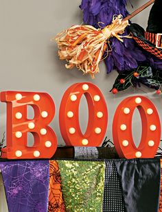 Boo it up in lights: arrange our charmingly chic Battery-operated BOO Marquee Letters in any room you like – they're cordless, crafted from metal, painted orange, and lit with warm white LED globes.