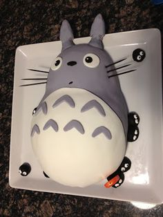 Totoro Cake. Birthday idea? (of course,  he'd be frosted because we're not good enough for fondant)