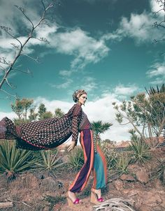 This is a unique look because of the interesting color palette as well as the pose of the model. The pants make a huge statement as well as the cape. #beautyfashion
