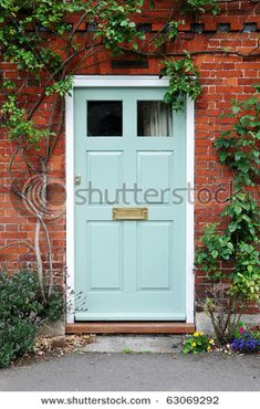 Pale aqua front door looks great with red brick.  Who knew?!