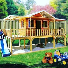 Playhouse with a deck and sand pit.the most perfect outdoor play area