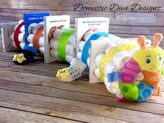 Diaper Cake - Book Worm Caterpillar, Primary Color Book Theme Baby Shower Diaper Cake Centerpiece by DomesticDivaDesignz on Etsy https://www.etsy.com/listing/462569429/diaper-cake-book-worm-caterpillar