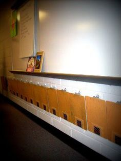 What a neat way to store individual student clipboards! Glue hooks underneath the whiteboard or another area of the room. Each student's number is on there too. This could be a great way to let students work anywhere in the room. Or any missing word could be put on the boards. So many ways to utilize these!!