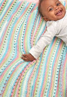 Free Knitting Pattern for Easy Self-Striping Baby Blanket - This easy blanket is featured garter stitch eyelet rows that add texture and showcase self-striping yarn. Designed by Nancy J. Thomas for Red Heart.