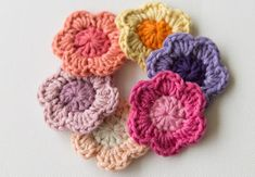Crochet flowers are quick and fun to make, and a must in any crocheter's pattern arsenal! | Difficulty: Beginner; Length: Quick; Tags: Crochet, Decorations, Faux Flowers, Gift Ideas, Yarn, Crochet Hook, Darning Needle, Scissors
