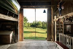 White's farm in North Brooklin, Maine on Allen Cove, a small inlet in Blue Hill Bay. The interior of the barn, looking out to the fields. Hanging in the doorway is the rope swing made famous in E. White's 1952 children's classic, Charlotte's Web. Eb White, White Barn, White House Tour, Maine Real Estate, Charlottes Web, Blue Hill, American Literature, White Houses, Maine House