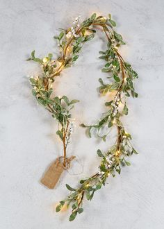 Sparkly mistletoe Christmas garland with white detailing and LED lights. Dimensions: 170cm x 20cm.
