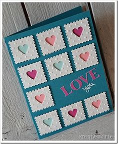 Love card with punched out hearts, embossed squares, and stamp perfed edges
