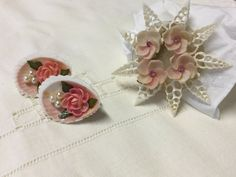 1950s original shell jewellery. Brooch and earring set. Delicate handcrafted shell and diamanté flowers on original mounts. Brooch has a pin clasp and earrings are clip-on.