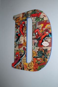 """10 Creative Ways to use Mod Podge - DIY for Life - Mod Podge projects aren't just for girls.  This letter 'D"""" was made for a little boy's nursery.  The comic book print is far from girly.  Two Busy Brunettes made this amazing statement piece."""