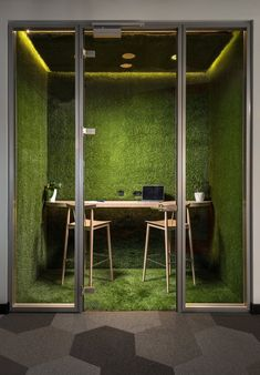 Moss meeting spaces take office greenery to a new level at eCommPay Offices #architectureoffice