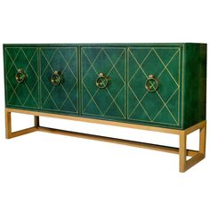 Mid Century Tommi Parzinger for Charak Leather-Wrapped Cabinet | From a unique collection of antique and modern cabinets at http://www.1stdibs.com/furniture/storage-case-pieces/cabinets/