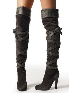 Every woman deserves at least one pair of over-the-knee length boots.  I'm not sure how you are supposed to walk in these, but they do look magnificent.