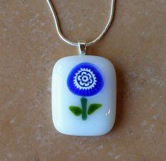 Blue Flower on White Glass