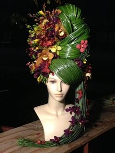 floral sculpture using orchids, freesia, and bear grass