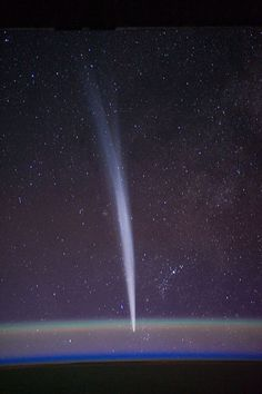 Comet Lovejoy is visible near Earth's horizon in this nighttime image photographed by NASA astronaut Dan Burbank, Expedition 30 commander, onboard the International Space Station on Dec. 22, 2011. :)