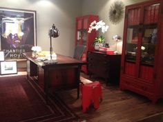 Upscale urban modern interior by Arini Subianto. Love the red cabinets.