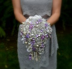 Deposit on lavender cascading jeweled brooch bouquet by Noaki, $275.00....i think this is it only not a cascade!!