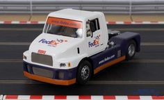 Flyslot Sisu racing truck in Federal Express fantasy livery. This is a very High Detail Slot Car. Real Racing, Slot Cars, Trucks, Dreams, Vehicles, Shop, Slot Car Tracks, Truck, Car