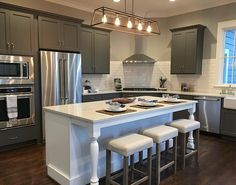 We love the color combination of the rich gray custom cabinets, white quartz counters, and beautiful dark wood floors. Visit the newly completed Leatherwood Cottage on Elyton Drive in the Town of Mt Laurel today!