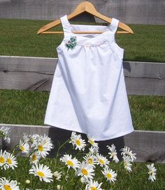Girls Sleeveless Pinafore Top Size 6/7 White Embroidered fabric featuring vintage lace. 16.00, via Etsy.